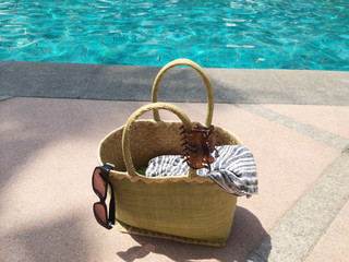Summer bag by swimming pool