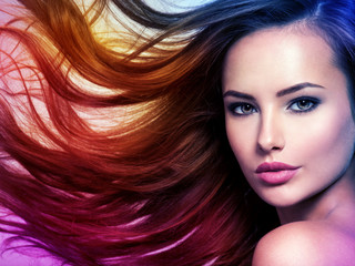 Beautiful woman with long brown hair. Tinted art photo
