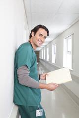 Male doctor standing in hospital corridor