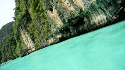 Limestone cliffs emerald green water, Phi Phi Island, Thailand