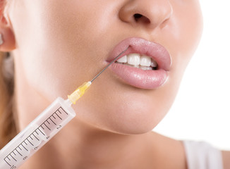 cosmetic injection to the lips of a beautiful woman