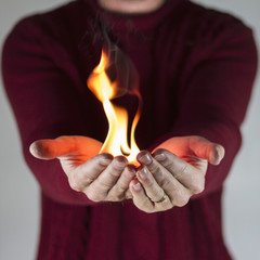 Man holding fire