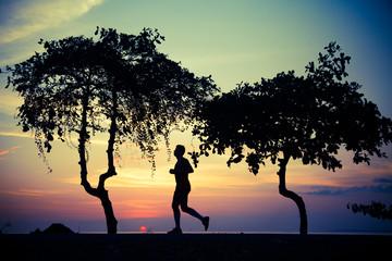 Costa Rica, Man jogging past trees