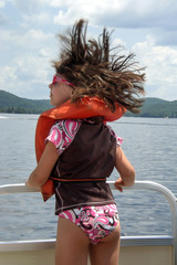 USA, New York State, Adirondack Mountains, rear view of girl (12-13) on boat