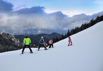Group of skiers on the mountain slope at high altitude