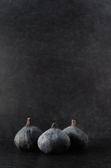 Three Figs Grouped on Black