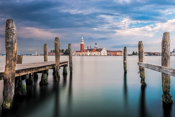 Italy, Venice, Wooden pier in water