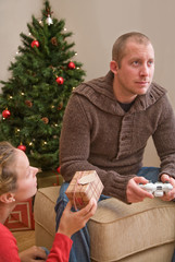 Man playing computer game at Christmas