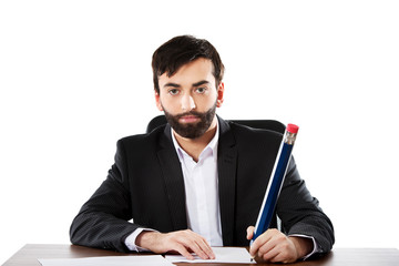Happy businessman writing in the office