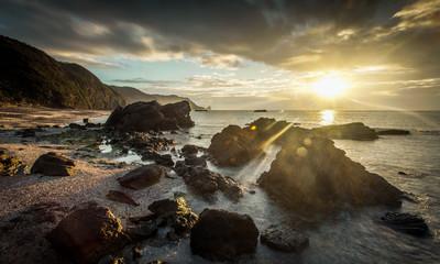 Japan, Okinawa, Sunrise over ocean and rocks