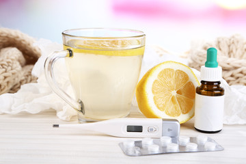 Hot tea for colds, pills and handkerchiefs