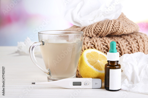 Fotobehang Thee Hot tea for colds, pills and handkerchiefs