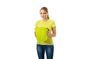 Young woman holding green bucket.