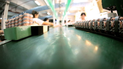 Factory assembly line moving with products, Mainland China