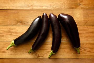Eggplants on wood table