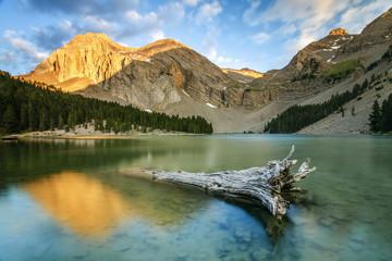 Spain, Catalonia, Huesca, Pyrenees, Lake at foot of mountain range