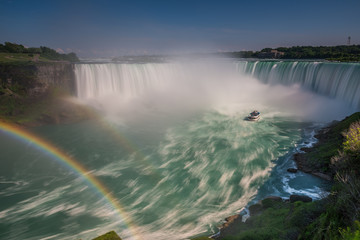Canada, Ontario, Niagara Falls, Double rainbow over water shot with long exposure