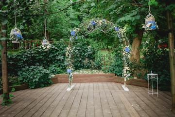 arch in a form offlower composition on a wedding ceremony