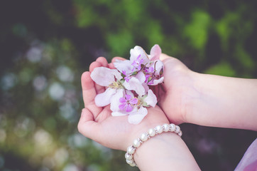 Girl with handful of flowers