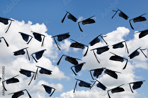 Leinwanddruck Bild airborne black graduation hats