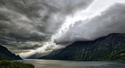 Norway, Ullensvang, Ullensvang herad, Lofthus, Sorfjorden, Dramatic sky over fjord