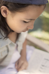 Spain, Malaga, Girl reading book and studying (10-11)