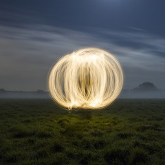 United Kingdom, Berkshire, Sphere made of light in meadow