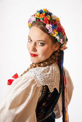 A young woman wearing a traditional Polish folk costume