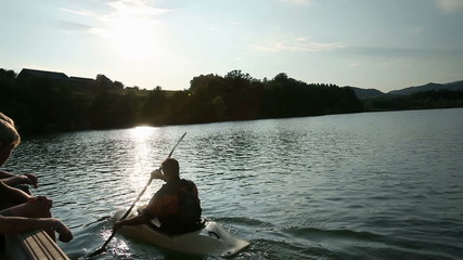 young people while canoeing on the lake