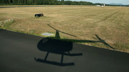 Shot of field with a shadow of heli