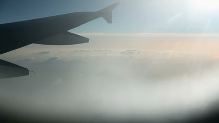 Flying above the clouds with airplane