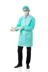 Male surgeon putting on protective gloves.