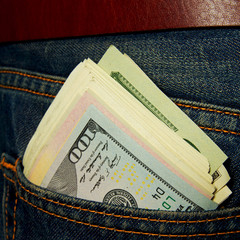 Dollars in jeans pocket.