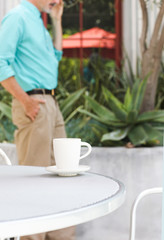 Businessman at cafe taking call