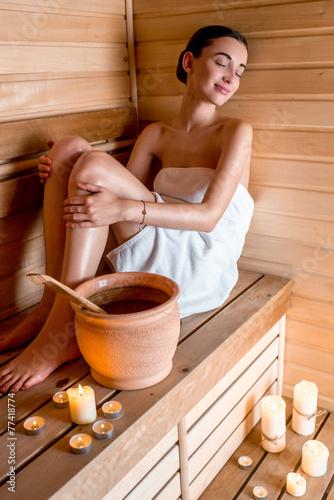 Woman in sauna - 77418774
