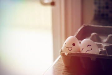 Eggs With Faces In Eggbox
