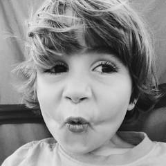 Portrait of boy making face
