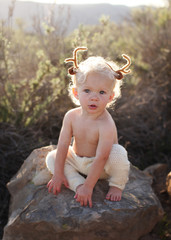 Toddler with antlers on his head