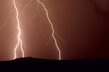 USA, Arizona, Arlington, Thunder bolt over Dixie Hill