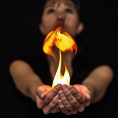 Woman holding playing with fire