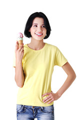Happy young woman eating an ice cream