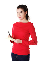 Woman writing notes and planning her schedule