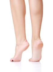 Back view of beautiful slim female legs