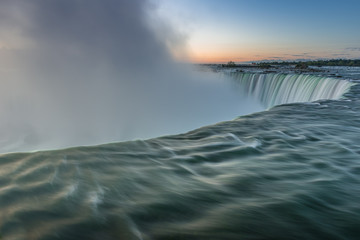 Canada, Ontario, Niagara Falls, Close-up shot of water splashing beyond edge of waterfall