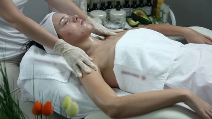 Young woman having a beuaty massage in a beauty spa