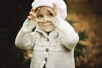 Child framing face with hands