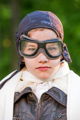 USA, Pennsylvania, Lancaster County, Lancaster, Portrait of boy wearing leather pilot cap and goggles