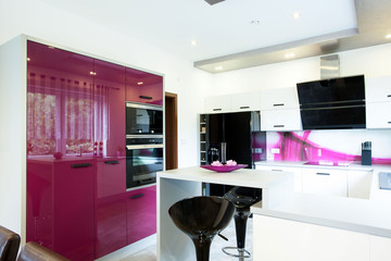 Modern kitchen with purple elements