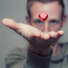 Man throwing dice in air