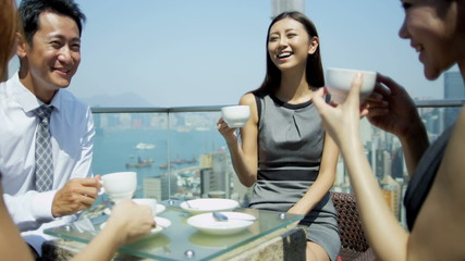 Young Ethnic Business People Outdoors Rooftop Restaurant
